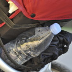 a bottle of water in a jogging stroller's basket