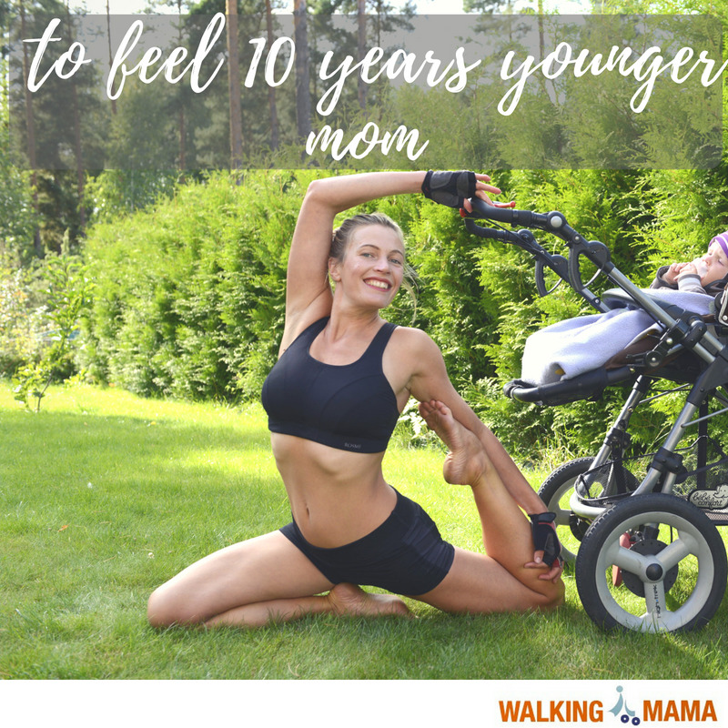 young mom performing joga asana next to the baby stroller