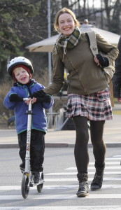 sporty chic mom wearing Wolford leggings, max mara socks, diesel flying jacket and tartan mini skirt with burnon backpack and fingerless gloves