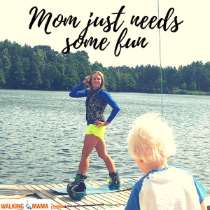 Young mom preprate to wakeboarding with the kid watching