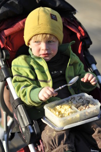 a child eats in a jogging stroller