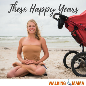 Young women in lotus pose in the beach with the stroller