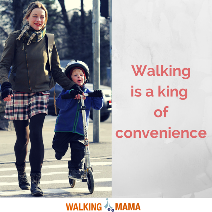A mom walking on the street with the litle boy